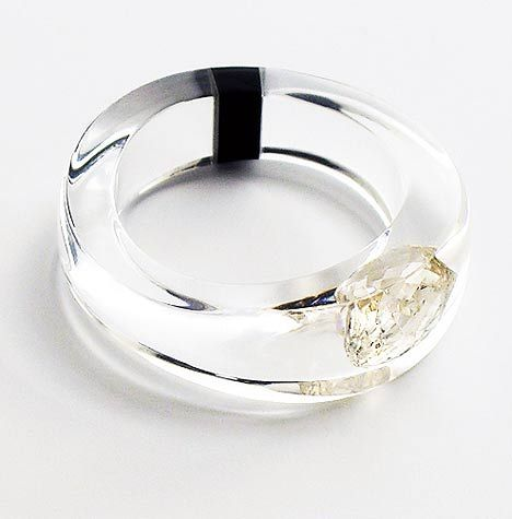 Keep your diamonds safe by having casting them in clear acrylic, as did jewellery designer Ted Noten while collaborating with Joost Lyppens.