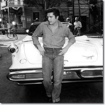 Elvis Presley with a 1957 Imperial Crown Convertible...