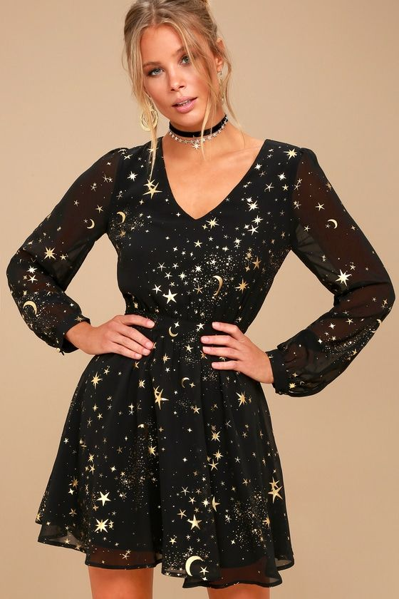 52800bcbe5ac02 You ll be as stunning as the heavens above in the Midnight Skyline Black  Star Print Long Sleeve Skater Dress! Metallic gold moon and star print  decorates ...