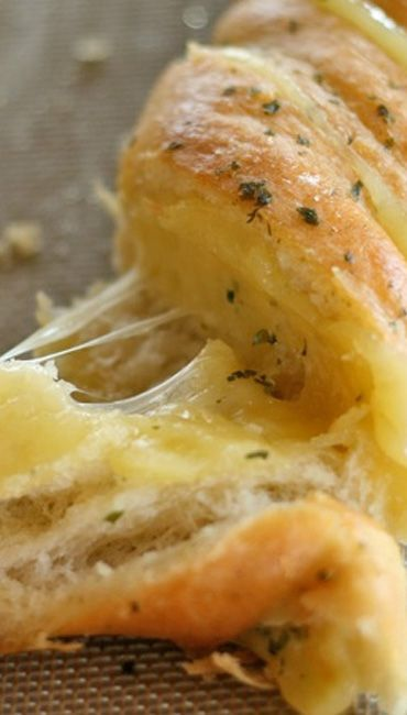 Hasselback Garlic Cheesy Bread.... So much butter, garlic, cheese, and bread! It's glorious!