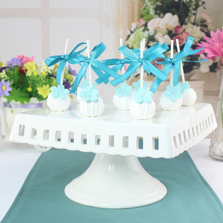 Купить товарБелый квадрат резьба керамическая свадебный торт стоит с пьедестала ноги в категории Миски и тарелкина AliExpress. Белый квадрат резьба керамическая свадебный торт стоит с пьедестала ноги