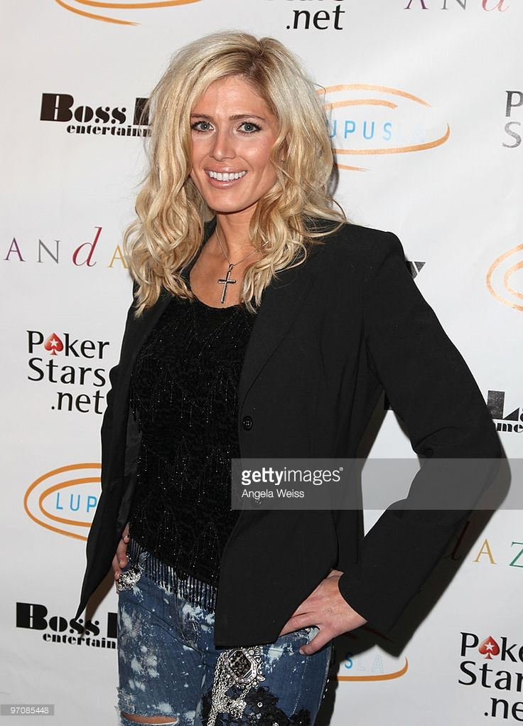 TV personality Torrie Wilson arrives at the 'Get Lucky for Lupus' celebrity charity poker tournament at Andaz West Hollywood on February 25, 2010 in West Hollywood, California.
