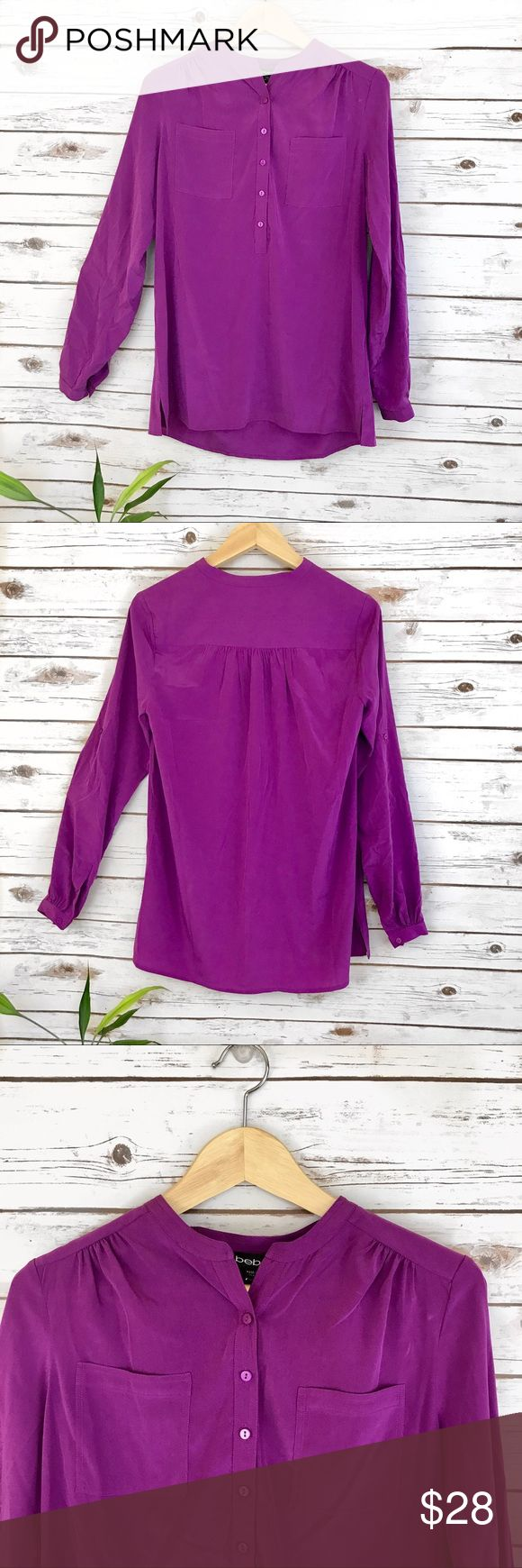 """Bebe Fuschia Pink Long Sleeves Top Bebe Valerie Crepe Silk Tunic. 2 front pockets. New with tag. From smoke free and pet free home. Has a small holes on the left sleeves but barely noticeable. See pictures for details.  Measurements laid flat: Armpit to armpit- 18"""" Length- 26"""" Sleeve length- 23""""  Make an Offer! No low-balling please. 😊❤️ bebe Tops Tunics"""
