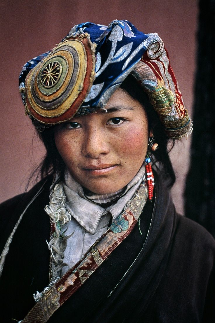 A young woman of Tibet dressed in beautiful hand made things -- we don't' know her name, but she certainly has style!