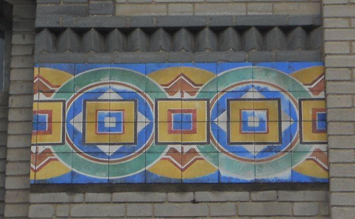 "Lisbon, A Napolitana, tile panel in the main building   António Cota Fevereiro. ""The Art Nouveau tiles as frames to architecture in Lisbon,"" in AzLab#14 Azulejos and Frames. Proceedings. 2 (2016), p. 62-74. URL: http://artison.letras.ulisboa.pt/index.php/ao/article/view/44"