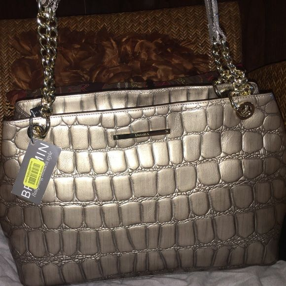 BIG PRICE DROP NWT $175!! Brahmin handbag MAKE OFFER!!!  ALL REASONABLE  OFFERS WILL BE SERIOUSLY CONSIDERED!!  NWT Brahmin leather handbag $170 off origionally price!!!!  alligator design, It's a beautiful silvery taupe color tote with gold chain and leather handles.  It comes with dust bag.  It's a $345 handbag! Brahmin Bags Totes