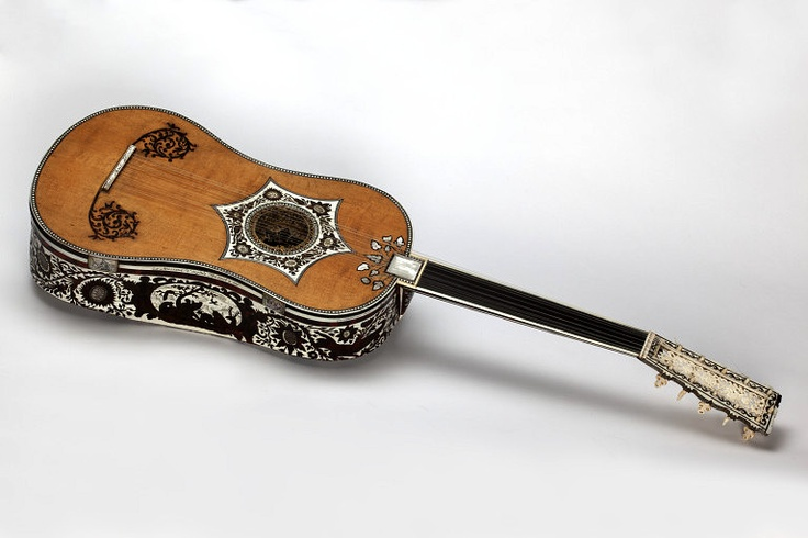 Guitar        Place of origin:        Hamburg, Germany (made)      Date:        1693 (made)      Artist/Maker:        Tielke, Joachim, born 1641 - died 1719 (maker)      Materials and Techniques:        Ivory and tortoiseshell veneer, with engraved marquetry, gilt vellum rosette and carved ivory openwork head
