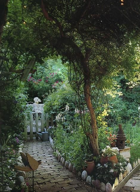 A pretty garden pathway with beautiful border edges.