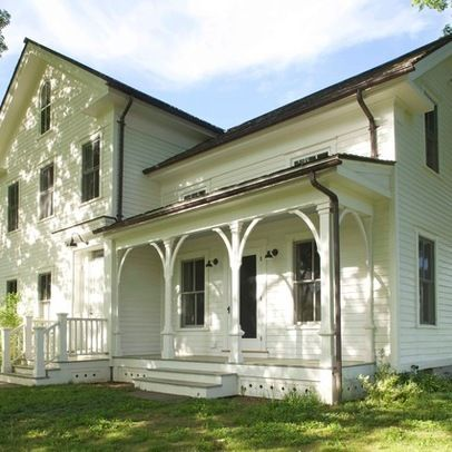 19th Century Farmhouse Renovation Basic form (center gable) is Greek Revival with added wings. Porch is style common for Italianate and Second Empire homes and is probably a later addition, perhaps about 20 years or so after the center section was built.
