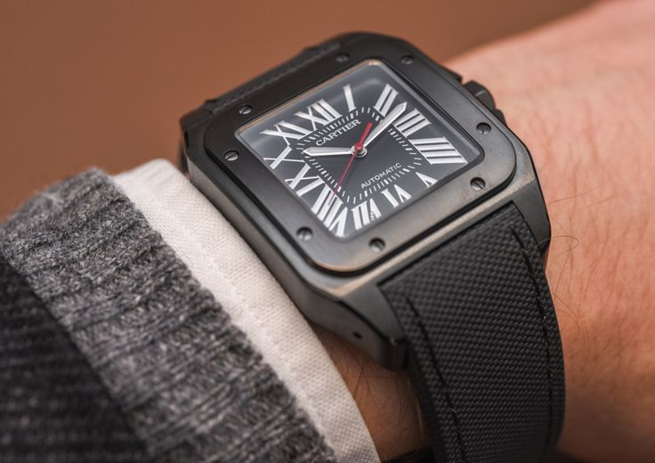 """Cartier Santos 100 Carbon Watch Hands-On - by Richard Cantley - More on the ADLC version of a classic at: aBlogtoWatch.com -""""Not too long ago, we covered the release of the Cartier Santos 100 Carbon and the Ballon Bleu De Cartier Carbon watches. Our interest was piqued by the idea that Cartier wanted to release these staples in ADLC, and now we have had a chance to spend some time with the Santos 100 Carbon. The result? Really, what you would expect. A classy, sleek, yet sportier…"""
