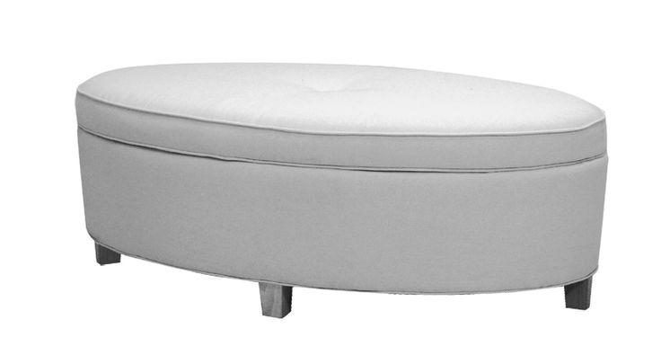 A contemporary-styled, oval-shaped storage ottoman with lift top and wood legs. Available in fabric or leather, the 52-inch-long piece is perfect for use with a sofa, two chairs or a sectional.