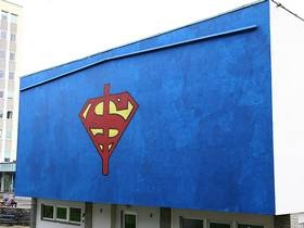 Custom piece by stencil artist Dolk, on a central wall of the Norwegian School of Economics.