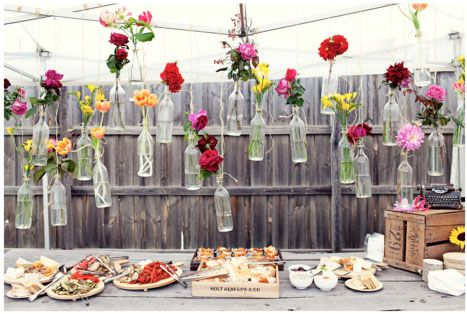 Simply stunning idea Create a pretty table centrepiece with this surprisingly simple flower-in-a-bottle idea. Recycle your old glass bottles and turn them into vases; group them randomly on the table or hang them from a branch or wire with some twine