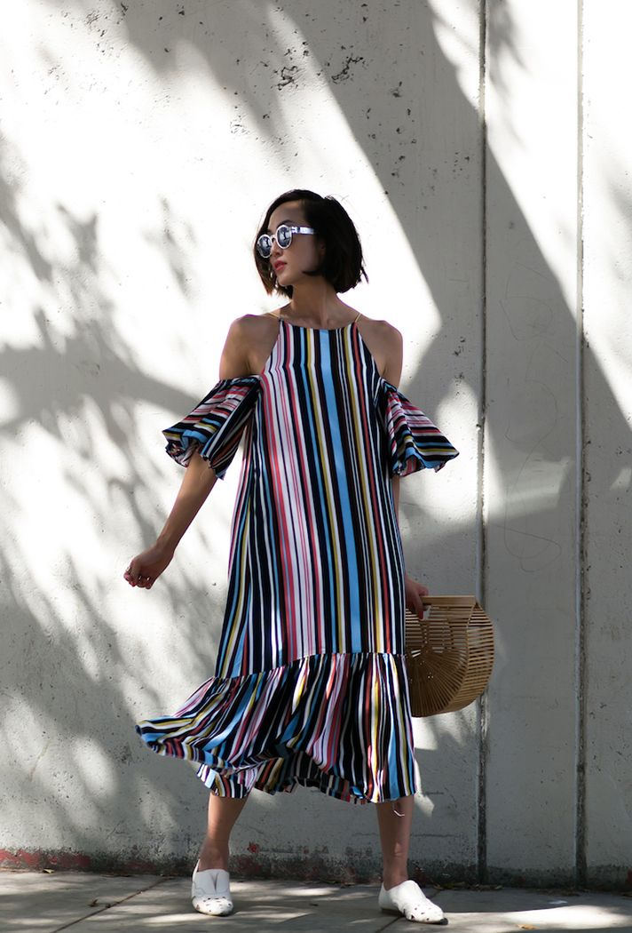Browse 20 picture-perfect picnic outfit ideas at @stylecaster | 'The Chriselle Factor' blogger in striped dress, white loafers