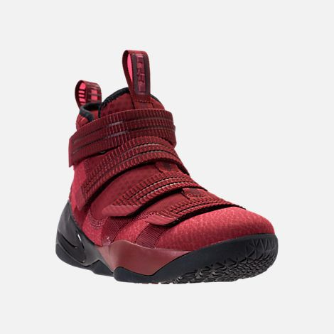 dc5bbe7ebc1 Three Quarter view of Men s Nike LeBron Soldier 11 SFG Basketball Shoes in  Team Red Black Total Crimson