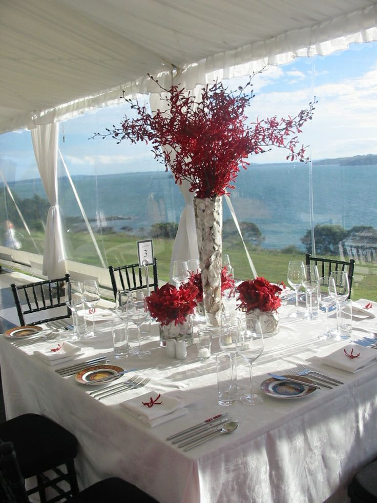 Flowers can add that 'pop' of colour to an overall white palette. Wedding co-ordinated by Waiheke Island Weddings and Events.