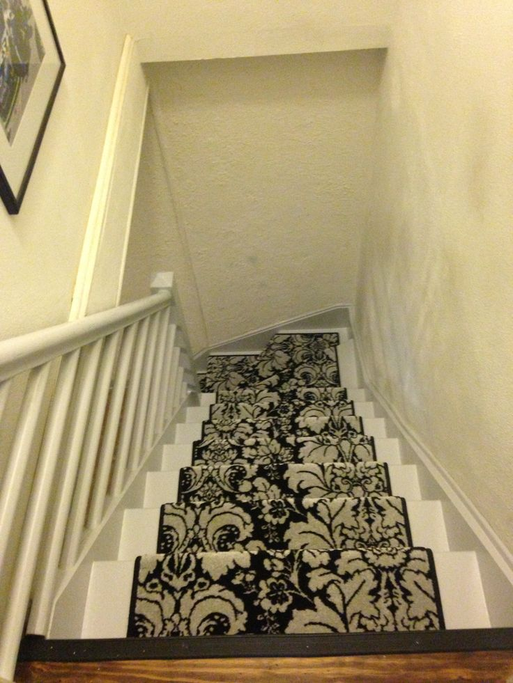 i bought a runner and painted the stairs a light grey stair