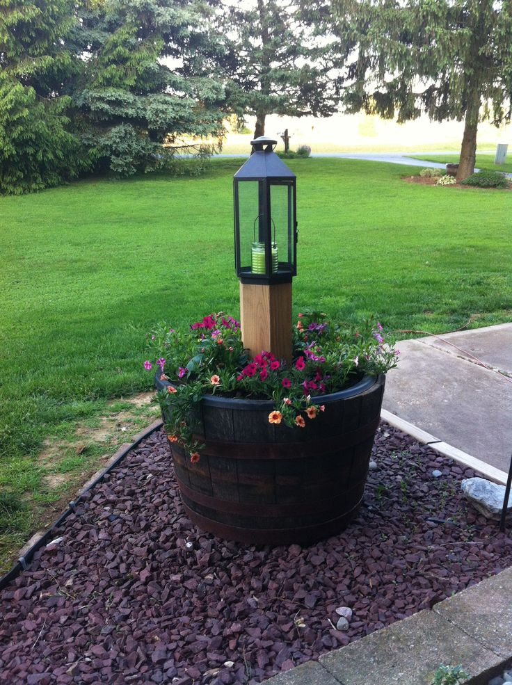35 best images about my whiskey barrels on pinterest for Yard planter ideas