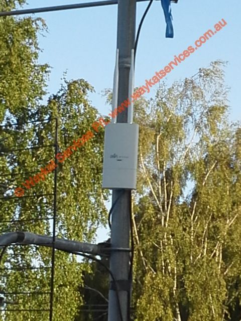 A view of another Ubiquiti Unifi Outdoor Wifi access point mounted on an existing TV antenna mast approx 8Ft above the roof line which is another 10 Ft above the ground this makes up another part of the segmented secure WiFi system that is used by both guests and staff with staff accessing the WiFi system via a full time WPA2 TKIP AES pass phrase