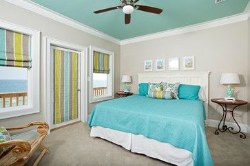 vaulted ceilings with curtains | contemporary bedroom by Greg Riegler Photography