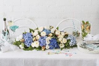 Stunning table arrangement of hydrangeas and waterlilies