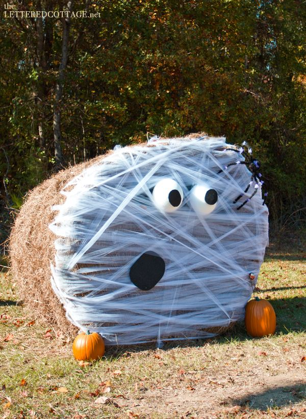 Halloween Hay Bales | The Lettered Cottage: Cute!  Could do a scaled down version with square bales?