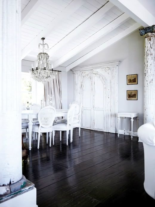 Love the contrast of these dark wooden floors with white shabby chic!