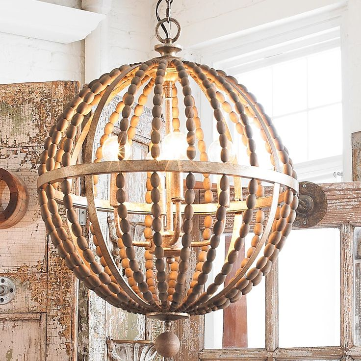 Wooden Bead Globe Chandelier Rustic wood beads create a globe with a light Bronze metal finish to form a classic transitional piece! 4x60 watts candle base lamps max. (23.75Hx18.25W)