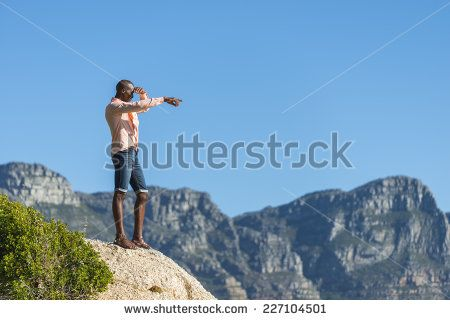 http://www.shutterstock.com/pic-227104501/stock-photo-african-black-man-standing-on-a-high-rock-overlooking-cape-town-as-he-points-and-scouts-the-blue.html?src=WuffEuvvGWj02MQSGcnIHQ-1-11 African Black Man, Standing On A High Rock Overlooking Cape Town As He Points And Scouts The Blue Sky, Ocean And Mountains On A Sunny Summers Day Stock Photo 227104501 : Shutterstock