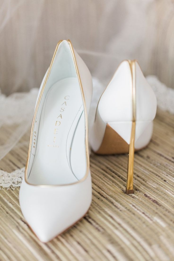 www.ScarlettAvery.com Beachy Miami Wedding at The Ritz-Carlton Bal Harbour, FL Stunning white and gold wedding shoes! Photographer: Landon Hendrick Photography