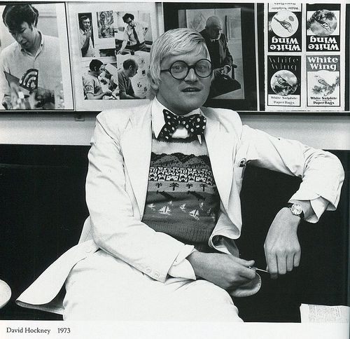 hockney may not have makeup on in this picture, but you just know he had a stack of pancake compacts on the counter of his powder room ...