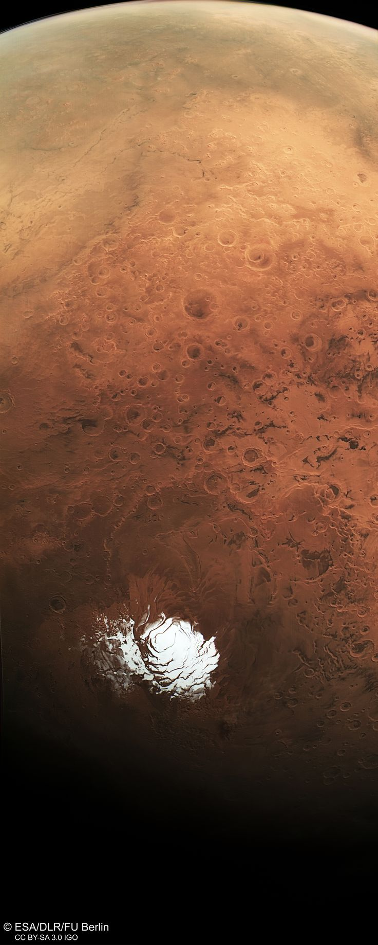 This sweeping view by ESAs Mars Express extends from the planets south polar ice cap and across its cratered highlands to the Hellas Basin (top left) and beyond
