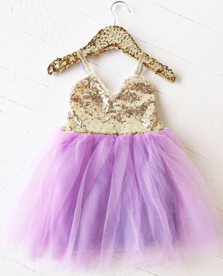 Perfect lavender and gold sequin dress with a layered tulle skirt and gold elastic straps.     Sizes: 18/24 months - 5T    *Washing Recommendations:  Hand wash and hang dry! DO NOT put clothing in the dryer to prevent shrinking and wear on the fabric.