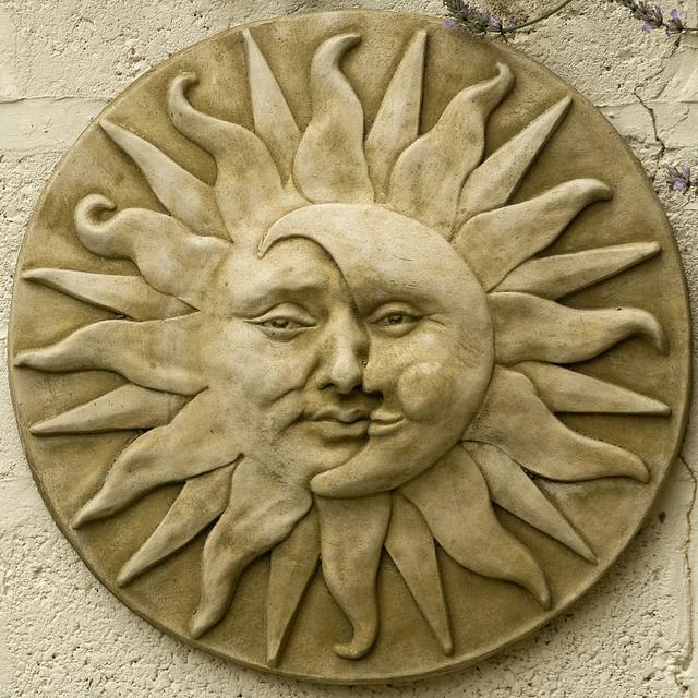 Garden plaque sun moon face by Oxo Cube, via Flickr