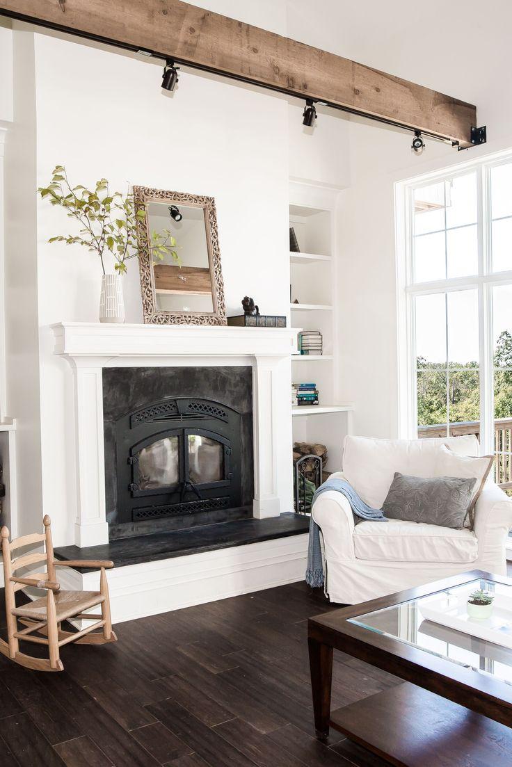 Crisp white walls with dark wood floors and light wood ...