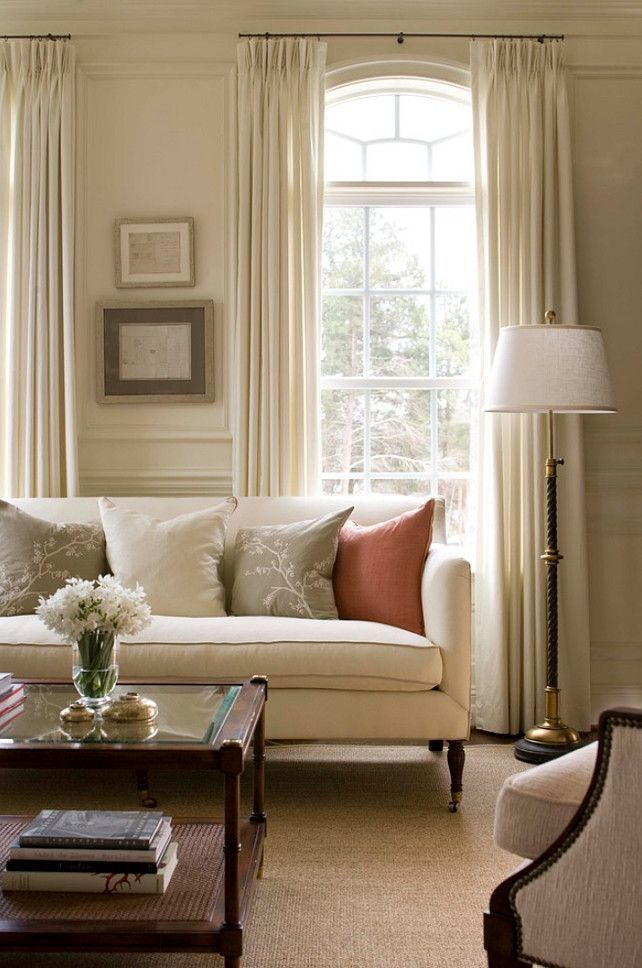 Beautiful soft creams and white compliment the glowing light of this stylish living room