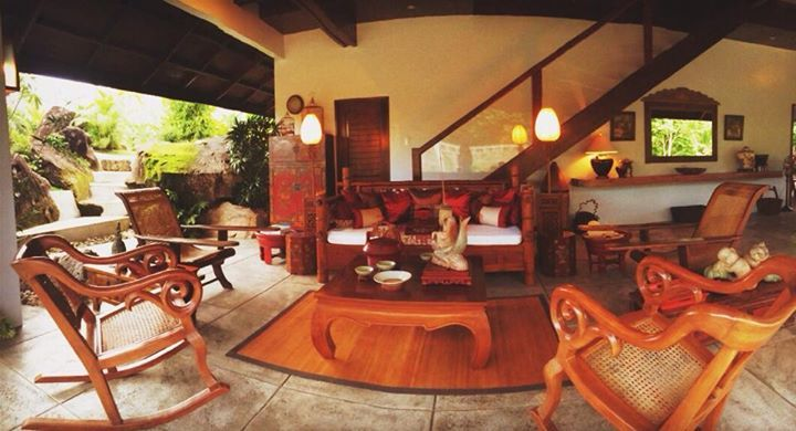 asian home in the Philippines.... Balinese daybed, Philippine rocking chairs and plantation chairs, Chinese coffee table and stand lamps, Tibetan cabinet.......