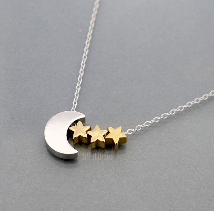 Moon Star Necklace, silver crescent moon tiny 3 gold stars dainty charm pendant, sterling chain, love mom, kid, baby, family love jewelry. $31.00, via Etsy.