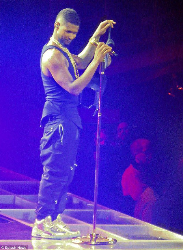 Hip hop chic: Usher also donned loose-fitted trousers with gold sneakers and a large gold ...