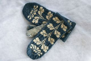 I made these mittens for my friend Katie, and because they turned out so nicely, I decided to write up a pattern and share it. It includes charts for the floral pattern and palm motif, as well as complete written directions.