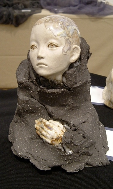 Ceramic sculpture of a child by Hiroko Igeta