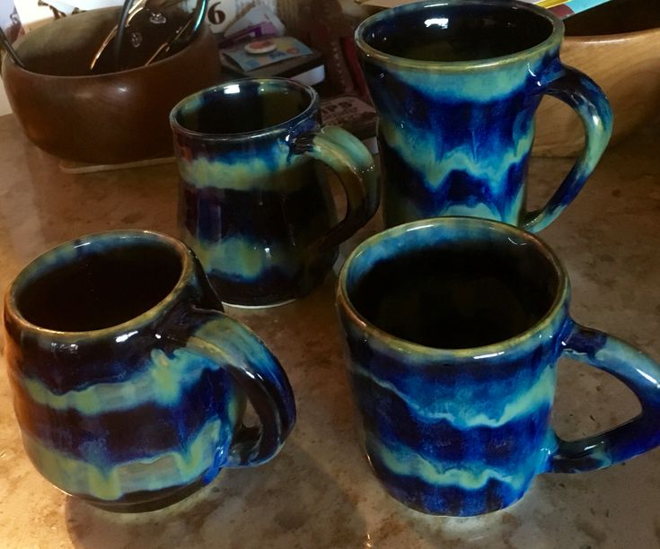 Glazed with stripes of obsidian and seaweed, textured turquoise, and indigo float then covered in indigo blue x2 with stripes of seaweed. Fired to cone 6. I love them