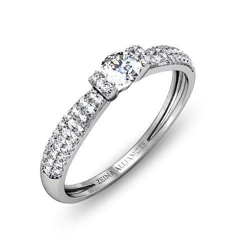 Cette bague de fiançailles est un solitaire diamant et or blanc pavé/clos. http://www.zeina-alliances.com/solitaire-diamant-rond/3979-telia.html