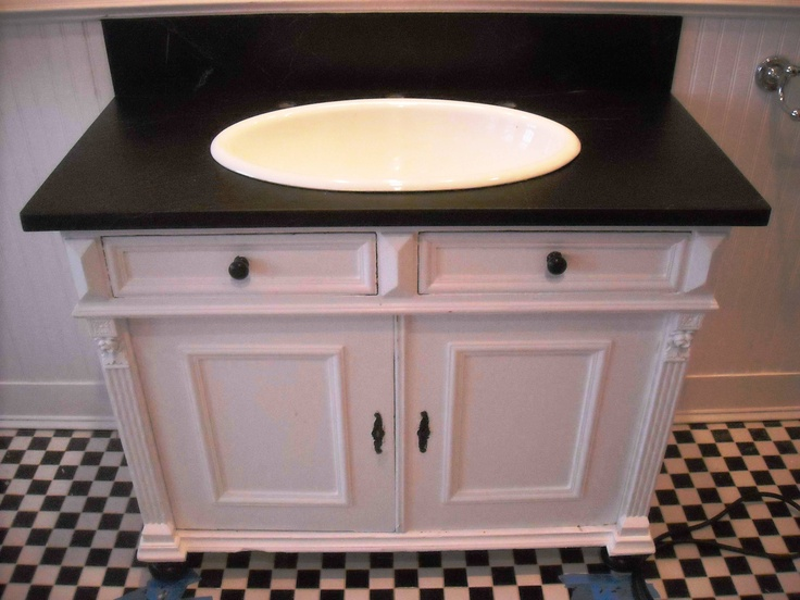 Soapstone Vanity And Backspash With White Sink Bowl.