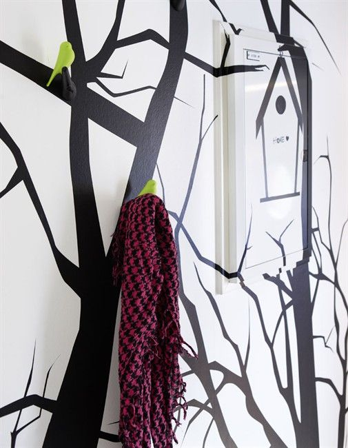 love this idea of painting trees on walls and then the little yellow bird hooks... adorable