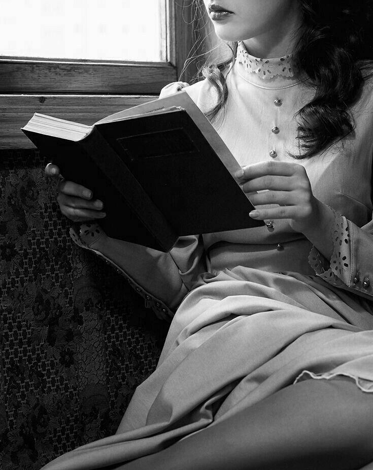 Sexy women reading books outside