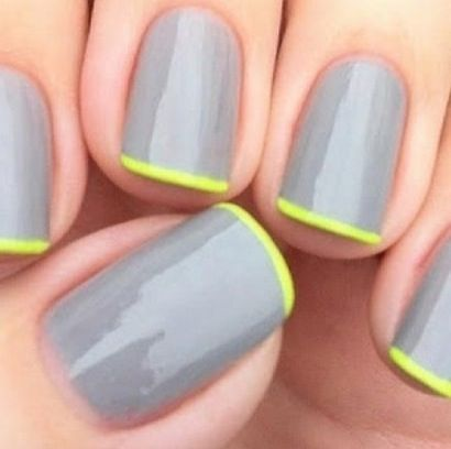 Gray manicure with a touch of a green French tip.  #nailperfection #beauty