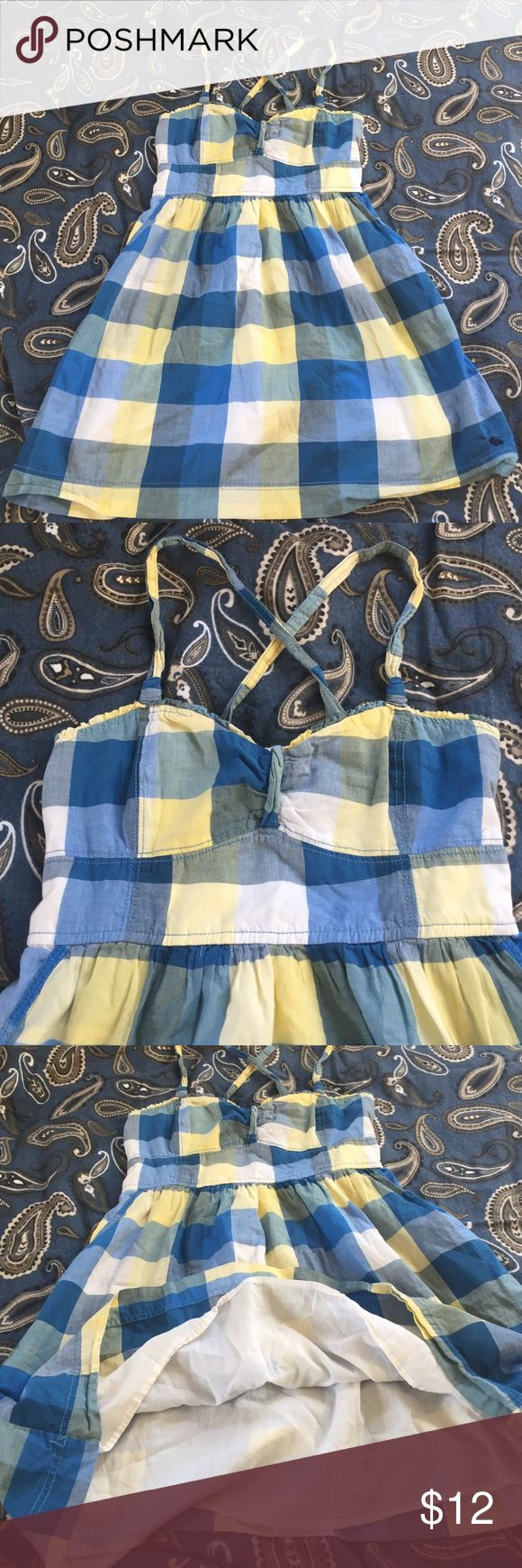 """Abercrombie plaid sundress, size L Blue and yellow check sundress by Abercrombie and Fitch. Size large has smocked back for nice for, and cross crossed straps. Bust is 30"""", waist 28"""" and length from waist to hem 18"""". 🦊 Please use measurements provided and ask all questions prior to purchase. I want happy customers! 😊 I do not model the clothes. Thanks! Abercrombie & Fitch Dresses Mini"""