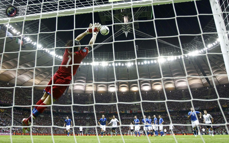 Italy's goalkeeper Buffon makes a save against Germany during their Euro 2012 semi-final soccer match at the National Stadium in Warsaw . KAI PFAFFENBACH/REUTERS