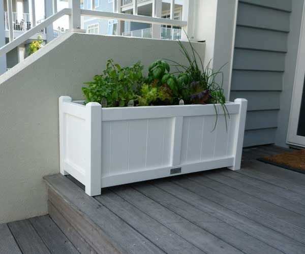 Small Trough Chamfered Posts Arctic White planted with kitchen herbs